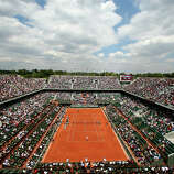 A general view over Philippe Chatrier court as Rafael Nadal of Spain serves in his Men's Singles match against Daniel Brands of Germany during day two of the French Open at Roland Garros on May 27, 2013 in Paris, France.