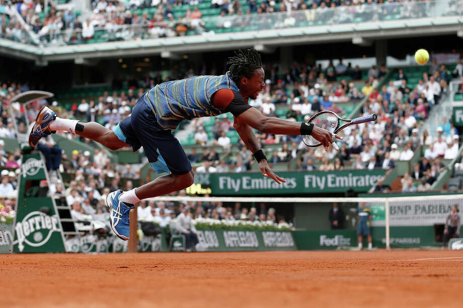 France's Gael Monfils dives in a try to return to Czech Republic's Tomas Berdych during their French Tennis Open first round match at the Roland Garros stadium in Paris, on May 27,  2013. Photo: THOMAS COEX, AFP/Getty Images / 2013 AFP