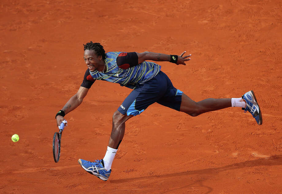 Gael Monfils of France plays a forehand in his Men's Singles match against Tomas Berdych of Czech Republic during day two of the French Open at Roland Garros on May 27, 2013 in Paris, France. Photo: Getty Images / 2013 Getty Images