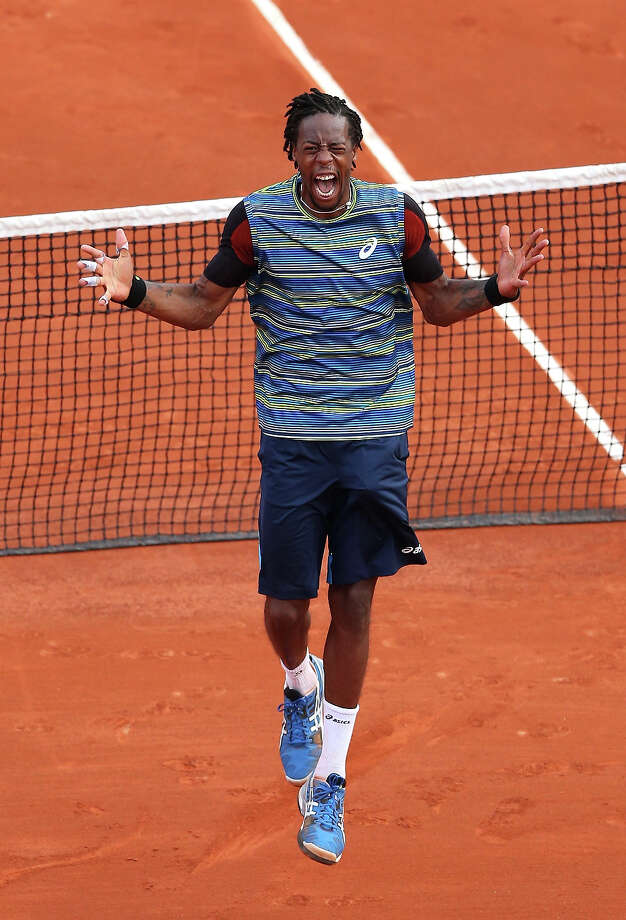 Gael Monfils of France celebrates match point in his Men's Singles match against Tomas Berdych of Czech Republic during day two of the French Open at Roland Garros on May 27, 2013 in Paris, France. Photo: Matthew Stockman, Getty Images / 2013 Getty Images