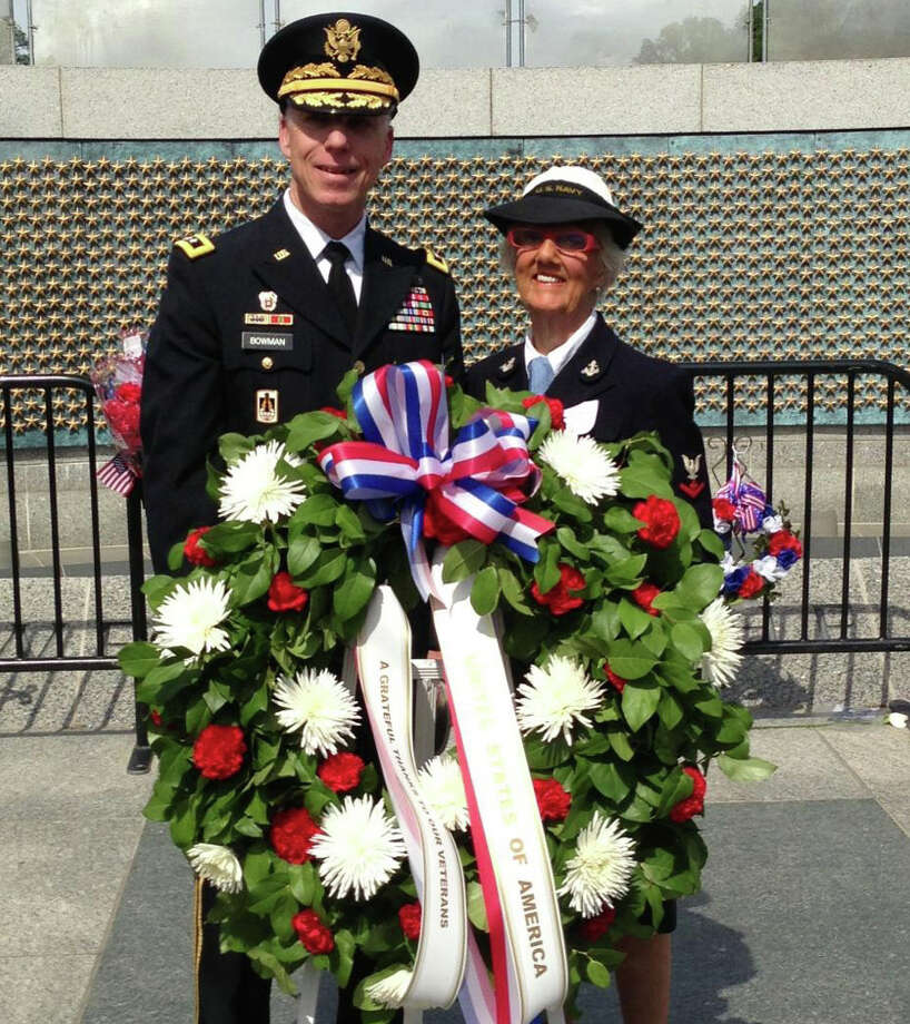 Anne Beers of Westport, who was a Navy pharmacist's mate during World War II, placed a wreath at the National World War II Memorial in Washington, D.C., during Memorial Day services Monday. With her is Lt. Gen. Mark Bowman, the keynote speaker for the ceremony. Photo: Contributed Photo / Westport News contributed