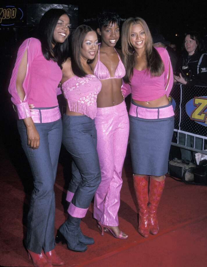 So, this is where those awful peekaboo sleeves came from! Also, a denim pant/denim boot combo is not OK, even if you draw a big pink shiny line between them. Photo: Ron Galella, WireImage / Ron Galella Collection