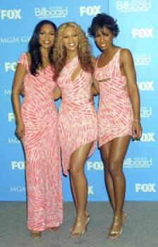 We feel like we're being sucked into the vortex between Michelle's and Beyonce's hips. Photo: Vinnie Zuffante, Getty Images / Archive Photos