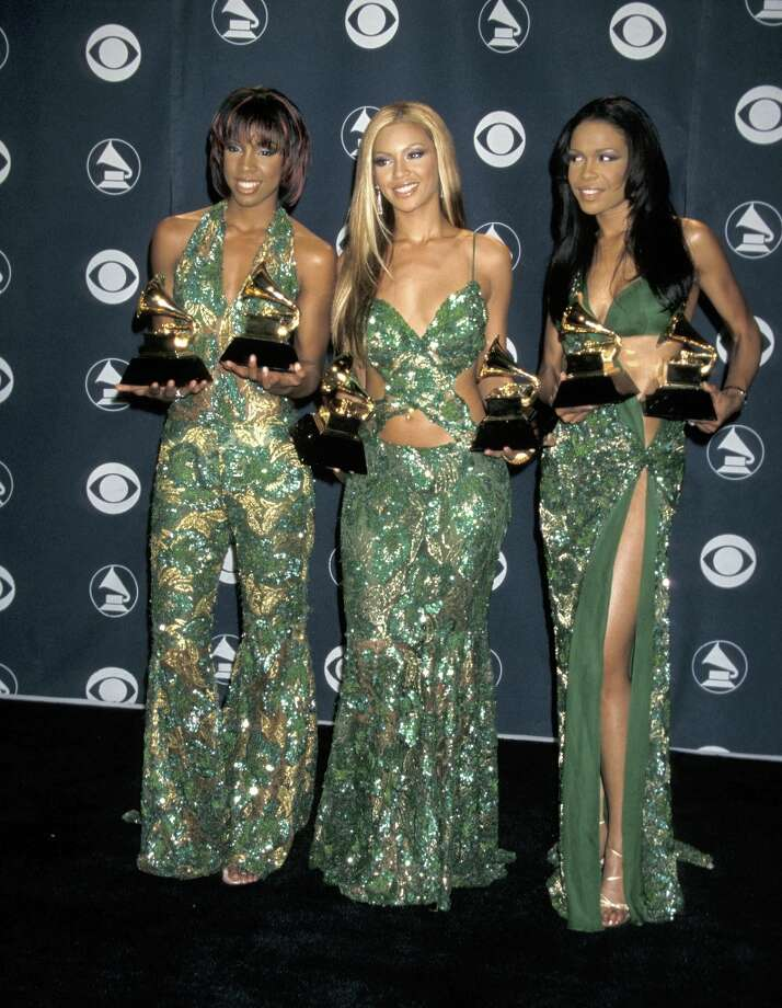 It is really difficult to distract from the shinyness of SIX Grammy awards, but they have done it. Photo: Jim Smeal, WireImage / Ron Galella Collection