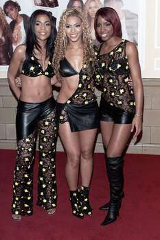 The fabric budget for the month came up a bit short. It was nice of Michelle to make a small sacrifice for Beyonce's boots. Photo: Dave Hogan, Getty Images / 2001 Getty Images