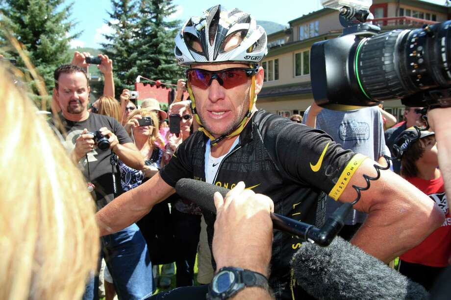 FILE - In this Aug. 25, 2012 file photo, Lance Armstrong talks to reporters after his second-place finish in the Power of Four mountain bicycle race at the base of Aspen Mountain in Aspen, Colo. Nike Inc. is cutting ties with the Livestrong cancer charity founded by Armstrong. The move by the sports company is the latest fallout in the doping scandal surrounding the former cyclist, who now admits he used performance-enhancing drugs to win the Tour de France seven times. (AP Photo/David Zalubowski, FIle) Photo: David Zalubowski, STF / AP