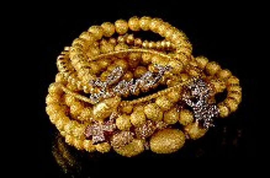 Beaded bracelets with diamond charms by Monka