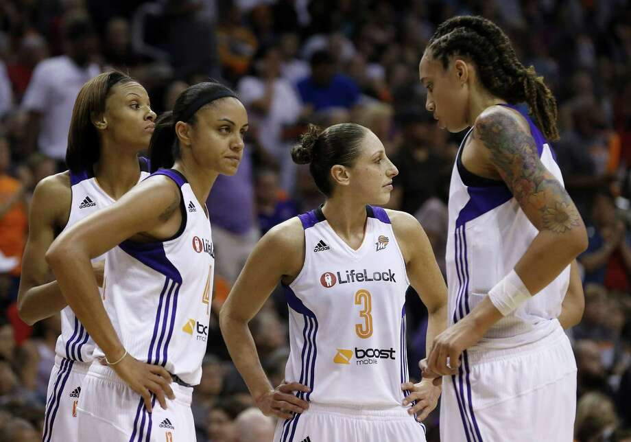 From left to right, Phoenix Mercury's DeWanna Bonner, Candice Dupree, Diana Taurasi, and Brittney Griner stand dejectedly on the court in the second half during a WNBA basketball game loss to the Chicago Sky on Monday, May 27, 2013, in Phoenix.  The Sky defeated the Mercury 102-80. (AP Photo/Ross D. Franklin) Photo: Ross D. Franklin, Associated Press / AP