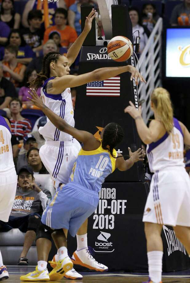 Chicago Sky's Epiphanny Prince (10) gets her shot blocked by Phoenix Mercury's Brittney Griner, left, as Mercury's Samantha Prahalis (99) looks on in the first half during a WNBA basketball game on Monday, May 27, 2013, in Phoenix. (AP Photo/Ross D. Franklin) Photo: Ross D. Franklin, Associated Press / AP