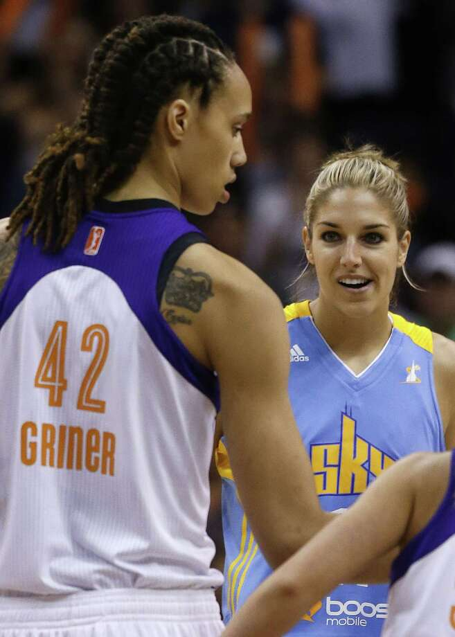 Chicago Sky's Elena Delle Donne, right, smiles as she looks at Phoenix Mercury's Brittney Griner (42) at the start of the first half during a WNBA basketball game on Monday, May 27, 2013, in Phoenix. (AP Photo/Ross D. Franklin) Photo: Ross D. Franklin, Associated Press / AP