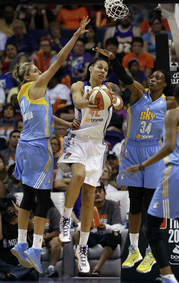 Chicago Sky's Elena Delle Donne (11) and Sylvia Fowles (34) defends Phoenix Mercury's Brittney Griner (42) as she tries to go up for a shot in the second half during a WNBA basketball game on Monday, May 27, 2013, in Phoenix. The Sky defeated the Mercury 102-80. (AP Photo/Ross D. Franklin) Photo: Ross D. Franklin, Associated Press / AP