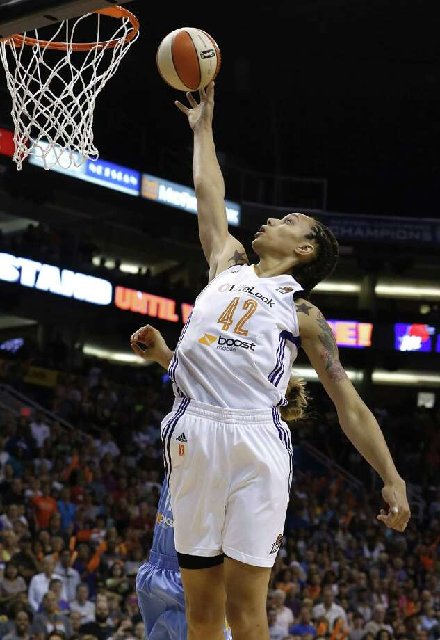 Phoenix Mercury's Brittney Griner scores her first basket in the first half during a WNBA basketball game against the Chicago Sky on Monday, May 27, 2013, in Phoenix. (AP Photo/Ross D. Franklin) Photo: Ross D. Franklin, Associated Press / AP