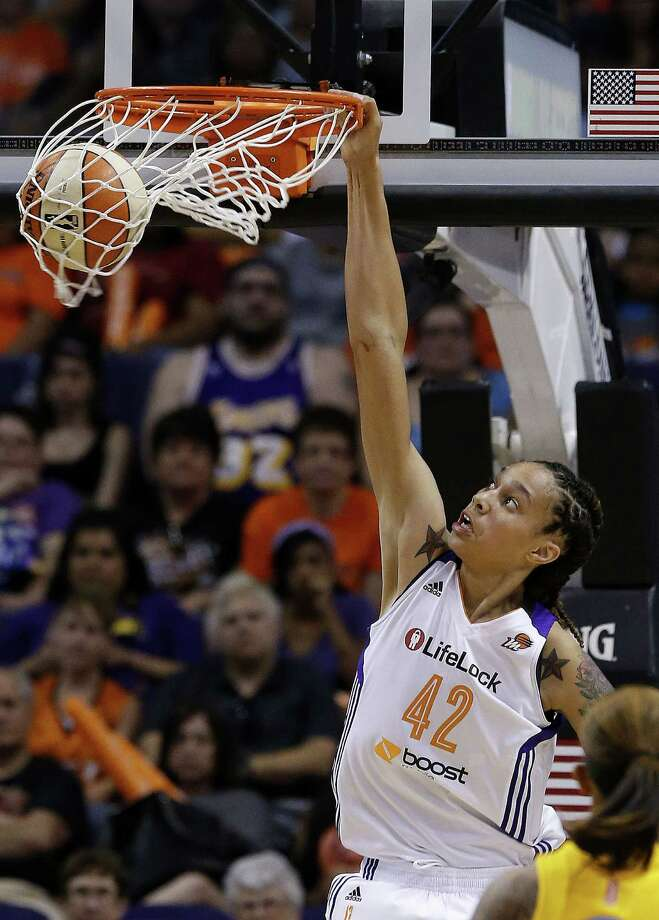 Phoenix Mercury's Brittney Griner gets her first dunk against the Chicago Sky in the second half during a WNBA basketball game on Monday, May 27, 2013, in Phoenix.  The Sky defeated the Mercury 102-80. (AP Photo/Ross D. Franklin) Photo: Ross D. Franklin, Associated Press / AP
