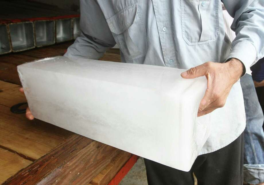 """Ice workerWhat Salary.com said: """"Before Mr. Edison came along, nothing happened when you pressed that button for ice on your Frigidaire. People had to rely on an iceman to deliver blocks of ice directly to their homes. Then they stored this ice in the icebox to preserve their perishables, and no one's arugula wilted in the heat of summer.""""Source: Salary.com Photo: AHMAD AL-RUBAYE, Getty Images / 2010 AFP"""
