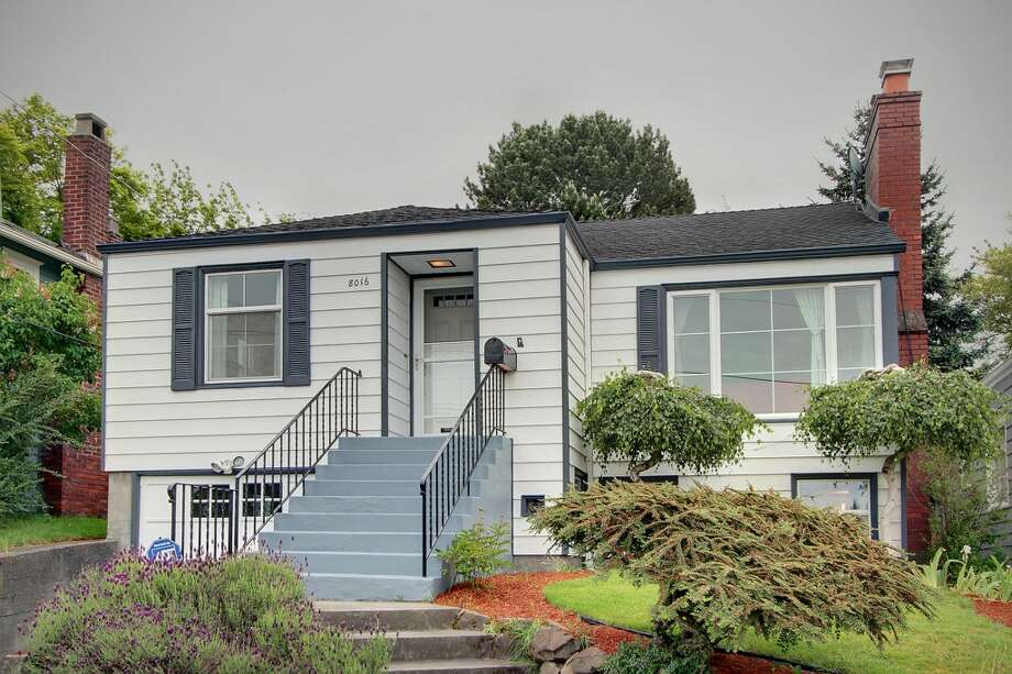 Tired of trying to find parking near Green Lake? With these four homes, listed for $629,000 to $649,900, you could walk to the lake. We start with the priciest, 8016 Stroud Ave. N. The 2,180-square-foot house, built in 1941, has three bedrooms, one bathroom, a family room with a fireplace, a built-in hutch and wainscoting in the dining room, and a covered back deck with skylights, lighting and gas on a 5,160-square-foot lot. Photo: Courtesy Vu To,  Century 21 Real Estate