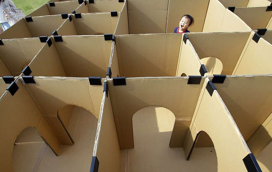 Is your child smarter than a lab rat? Check out his reasoning skills in this maze at a park in Tokyo. Photo: Shizuo Kambayashi, Associated Press