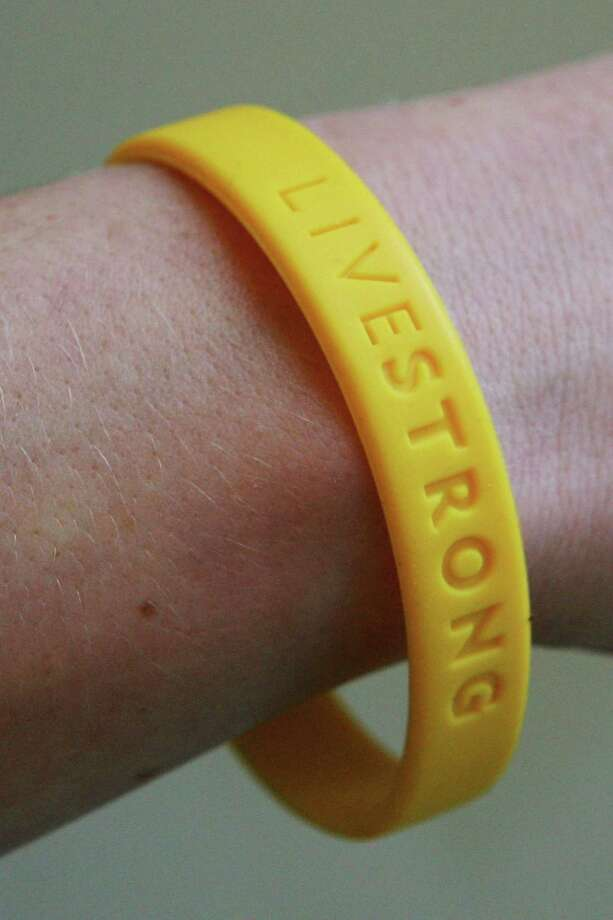 FILE - MAY 28: Nike announced May 28, 2013 that it is cutting ties to Lance Armstrong's charity Livestrong, in the aftermath of the cyclist's doping scandal. LONDON - JANUARY 27:  In this photo illustration a yellow band which represents the Lance Armstrong Foundation LiveStrong is sported in aid of the charitable event, January 27, 2005 in London, England. The bands have become popular and high light different campaigns. Photo: Scott Barbour, Getty Images / 2005 Getty Images