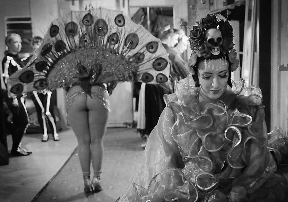 Peek performance:Costumed dancers wait backstage for their turn to compete in the Miss 