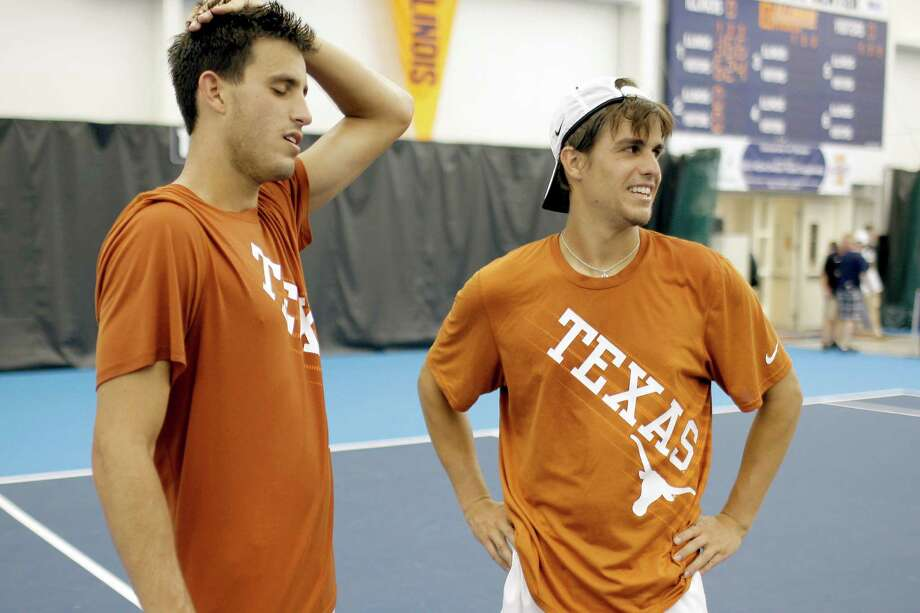Texas teammates David Holiner (left) and Chris Camillone react after their loss in a doubles match to Virginia's Jarmere Jenkins and Mac Styslinger in the NCAA men's tennis championship inside the Atkins Tennis Center Monday, May 27, 2013 on the University of Illinois campus in Urbana, Ill. (AP Photo/Stephen Haas) Photo: Stephen Haas, Associated Press / FR170194 AP