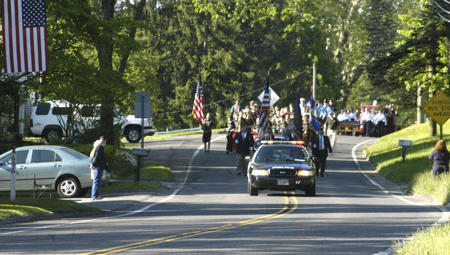 """""""Here they come!"""" was the word passed around Monday morning in Gaylordsville as the Memorial Day parade crested Route 7 just south of the village center. May 27, 2013 Photo: Norm Cummings"""