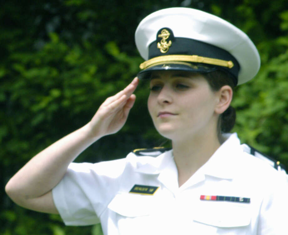 Midshipman 4th Class Rachel Berger of Sherman, in her third year at the United States Military Academy in Annapolis, Md., offers a heartfelt salute during Sunday's Memorial Day ceremony in her hometown. May 26, 2013 Photo: Norm Cummings