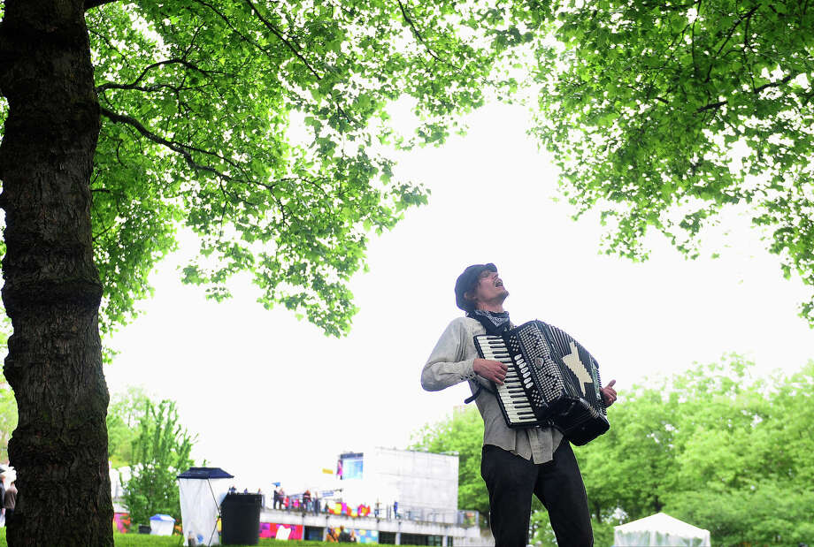 Evan Evanovitch of Cirk du Fantastik performs on the accordion during Folklife on Monday, May 27, 2013 at Seattle Center. The soggy Memorial Day weather brought out fewer crowds than previous days, but was still attended by thousands. (Photo by Lindsey Wasson) Photo: LINDSEY WASSON, SEATTLEPI.COM / SEATTLEPI.COM