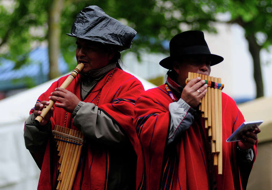 Members of the group Quichua Mashis perform during Folklife on Monday, May 27, 2013 at Seattle Center. The soggy Memorial Day weather brought out fewer crowds than previous days, but was still attended by thousands. (Photo by Lindsey Wasson) Photo: LINDSEY WASSON, SEATTLEPI.COM / SEATTLEPI.COM