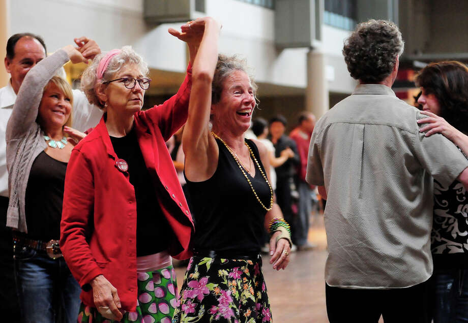 People learn how to dance the salsa inside the Armory during Folklife on Monday, May 27, 2013 at Seattle Center. The soggy Memorial Day weather brought out fewer crowds than previous days, but was still attended by thousands. (Photo by Lindsey Wasson) Photo: LINDSEY WASSON, SEATTLEPI.COM / SEATTLEPI.COM
