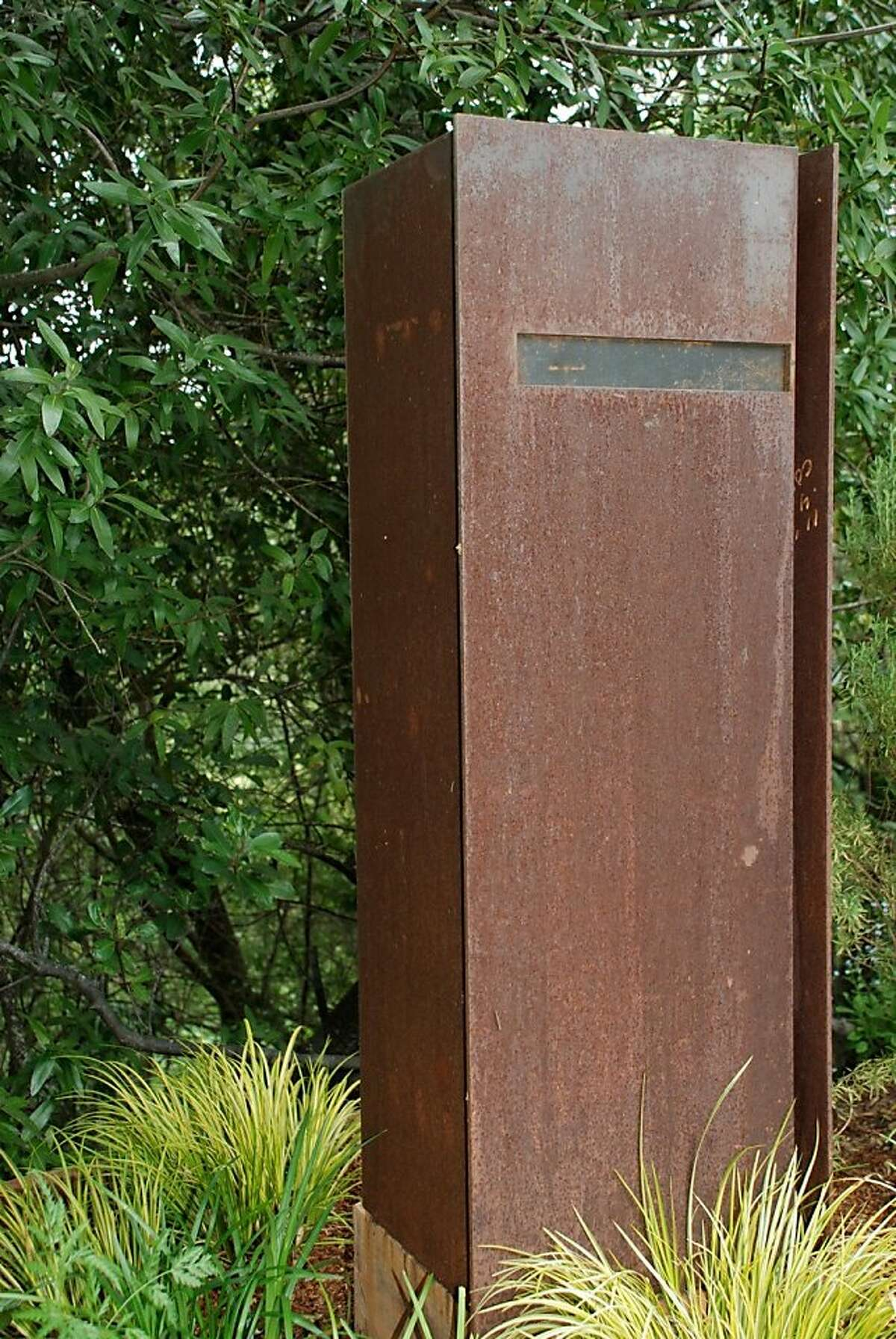 Caption info: Davis Dalbok and Tim O Shea used Cor-Ten steel for the mailbox. As Cor-Ten oxidizes, it s patina shifts. Dalbok describes it as very dynamic, very active.