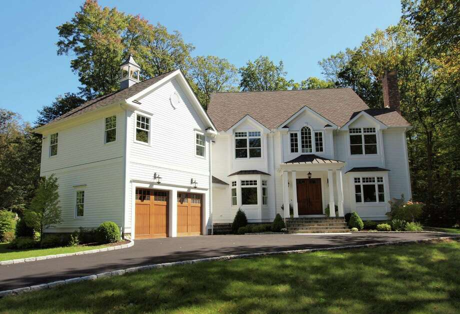 This new Colonial at 3 Tupelo Road is on the market for $2.3 million. Photo: Contributed Photo / Westport News contributed