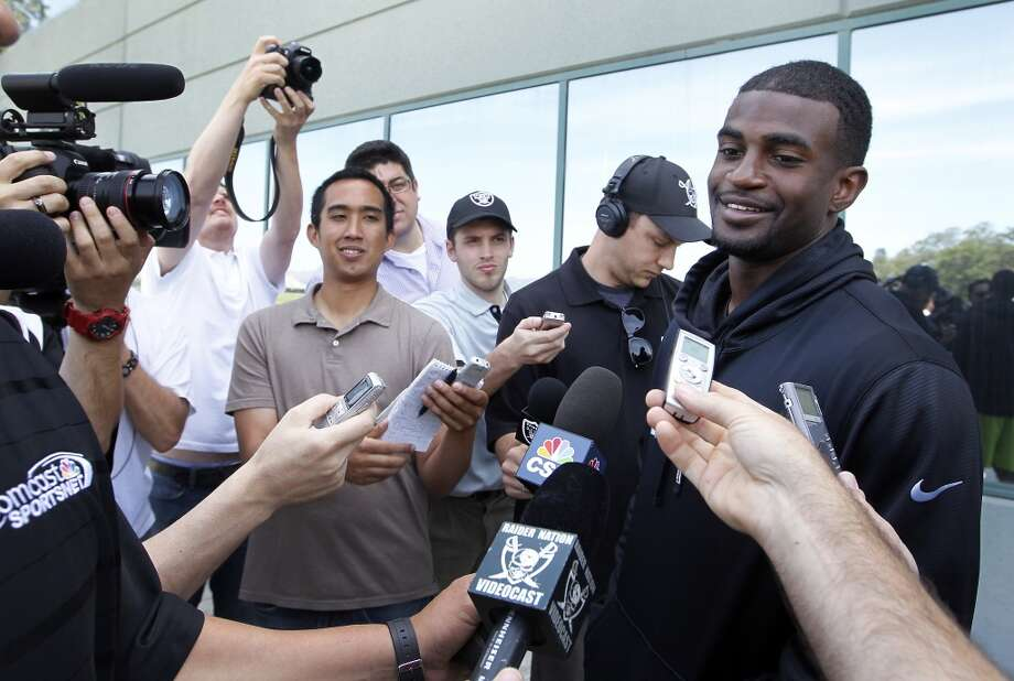Oakland Raiders cornerback D.J. Hayden, right, speaks with reporters during practice at NFL football rookie camp at the team's training facility in Alameda, Calif., Saturday, May 11, 2013. (AP Photo/Tony Avelar)