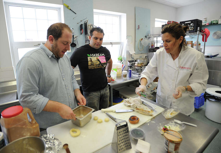 From left; Joel Gamoran, head chef of Sur La Table in New York City, Biagio Barone, co-founder of Iskream and owner of Biagio's Osteria in Stratford, and Susan Patrick, co-founder of Iskream and owner of Walnut Beach Creamery, experiment with healthy summer dessert recipes at Walnut Beach Creamery in Milford, Conn. on Tuesday, May 28, 2013. Photo: Brian A. Pounds / Connecticut Post