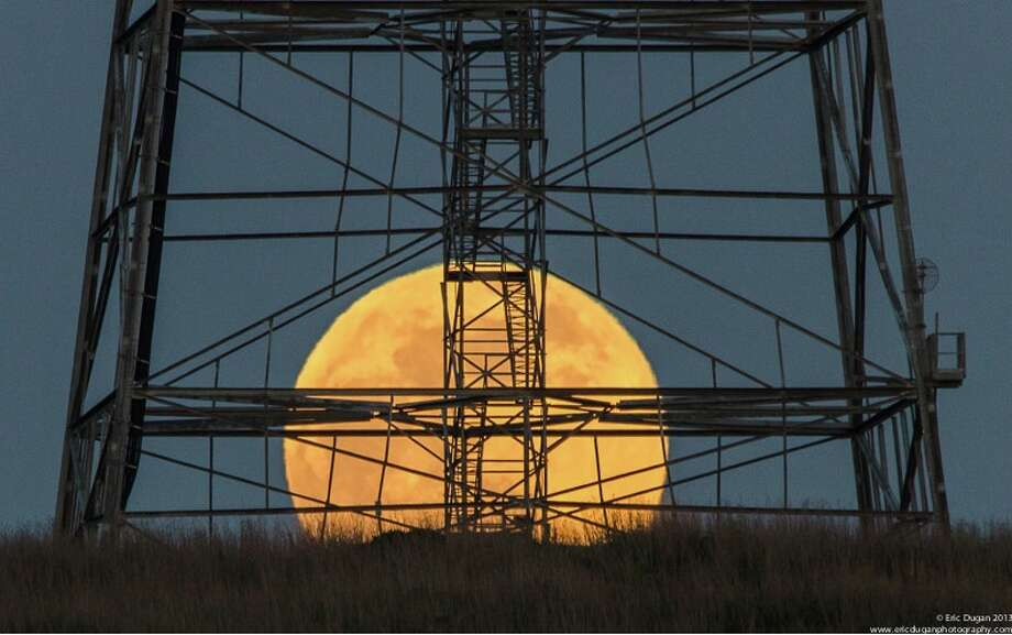 Moon rise captured behind an electrical tower at Glen Cove