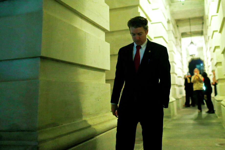Sen. Rand Paul, R-Ky., walks out of the Capitol after his filibuster of the nomination of John Brennan to be CIA director on Capitol Hill in Washington, early Thursday, March 7, 2013. Senate Democrats pushed Wednesday for speedy confirmation of John Brennan's nomination to be CIA director but ran into a snag after Paul began a lengthy speech over the legality of potential drone strikes on U.S. soil. But Paul stalled the chamber to start what he called a filibuster of Brennan's nomination. (AP Photo/Charles Dharapak) Photo: Charles Dharapak, Associated Press / AP