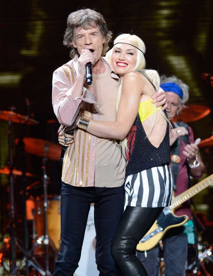 "Mick Jagger and Gwen Stefani perform on stage during the Rolling Stones ""50 & Counting"" tour opener at Staples Center on May 3, 2013 in Los Angeles, California.  (Photo by Kevin Mazur/WireImage)"