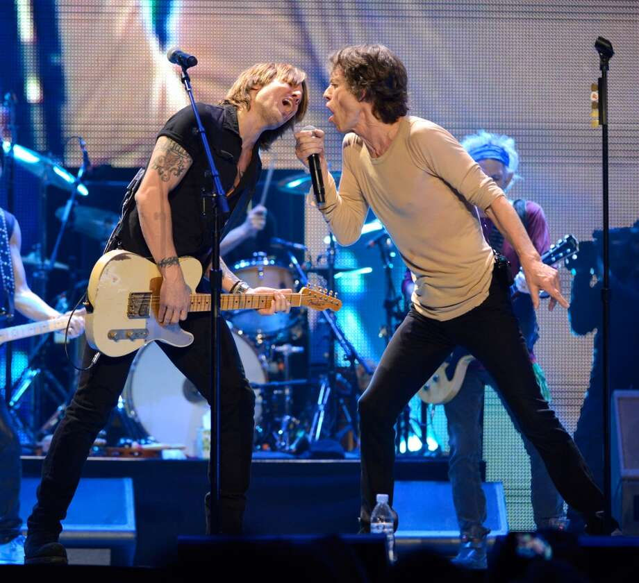 "Keith Urban and Mick Jagger perform on stage during the Rolling Stones ""50 & Counting"" tour opener at Staples Center on May 3, 2013 in Los Angeles, California.  (Photo by Kevin Mazur/WireImage)"