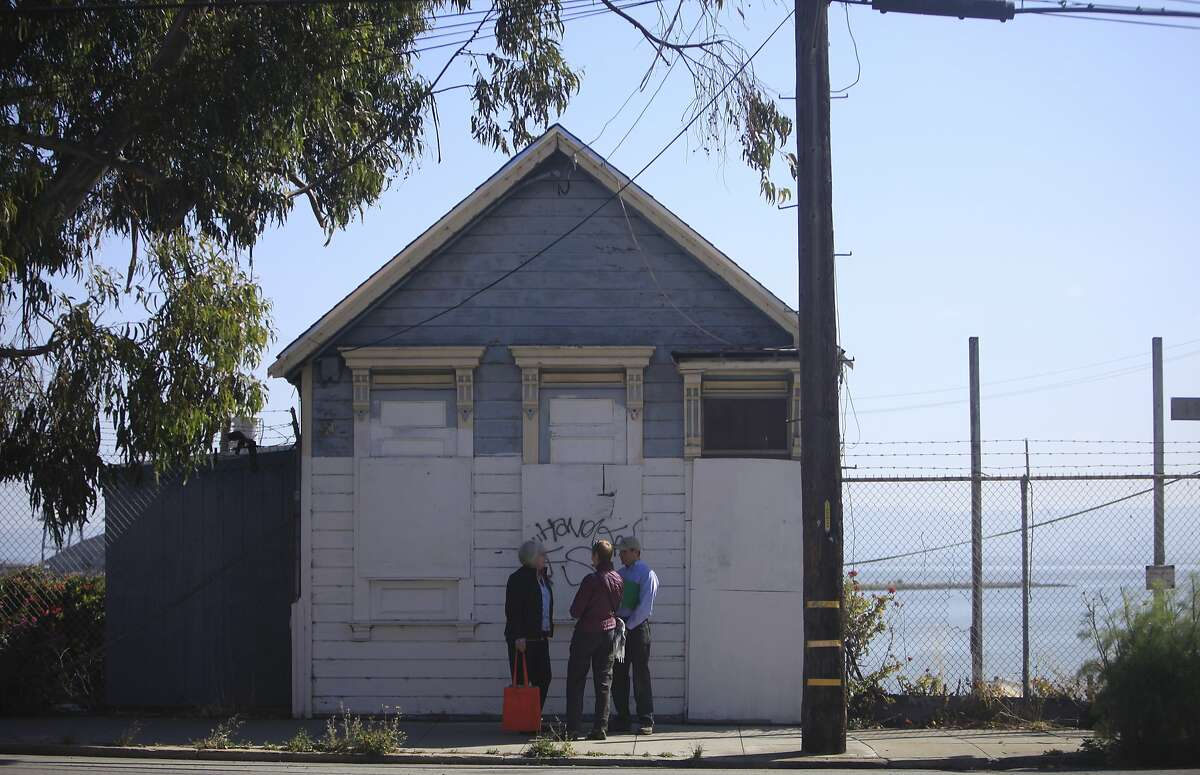 Jill Fox (l to r)of the India Basin Neighborhood Association; Rosemary Cameron, board president of the San Francisco Parks Alliance; and Matt O'Grady, executive director of the San Francisco Parks Alliance stand in front of the Shipwright's Cottage at 900 Innes Street on Thursday, May 23, 2013 in San Francisco, Calif.