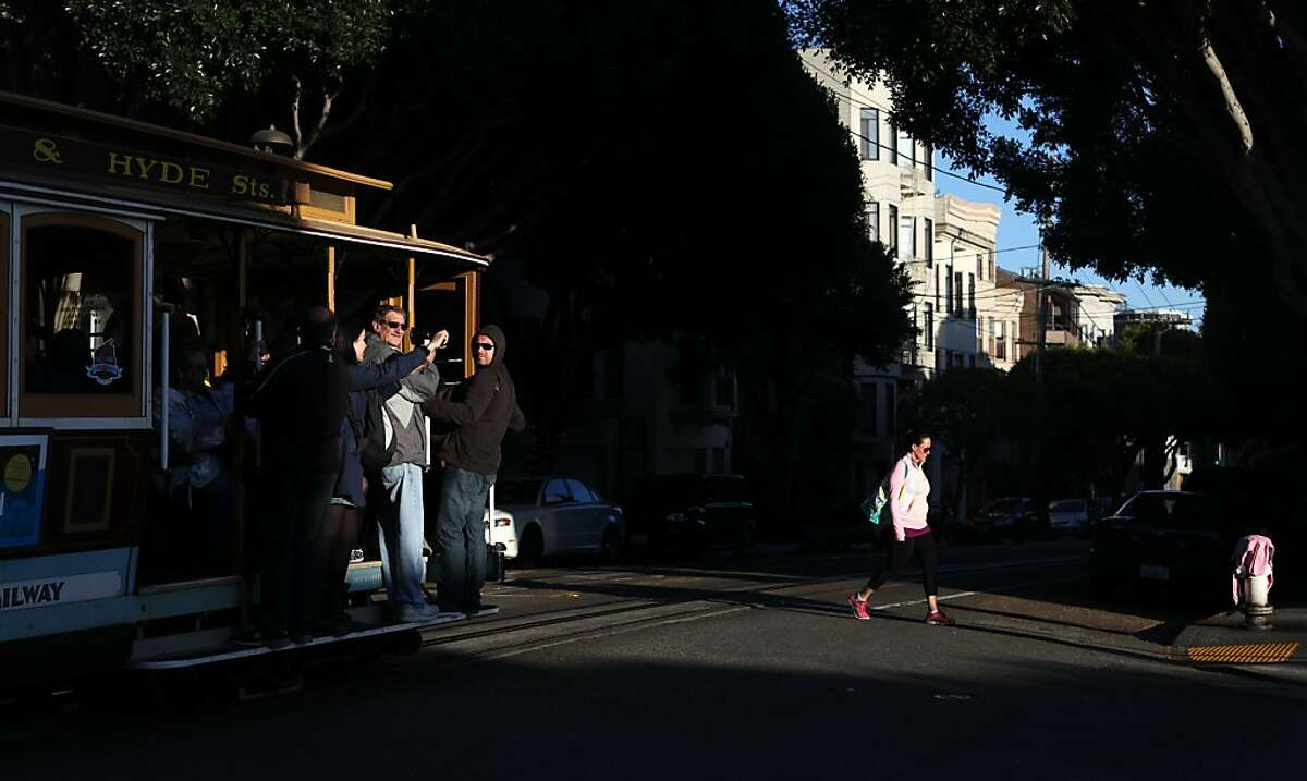 A cable car passes Green Street on Hyde Street on May 23, 2013 in the Russian Hill area of San Francisco, Calif.