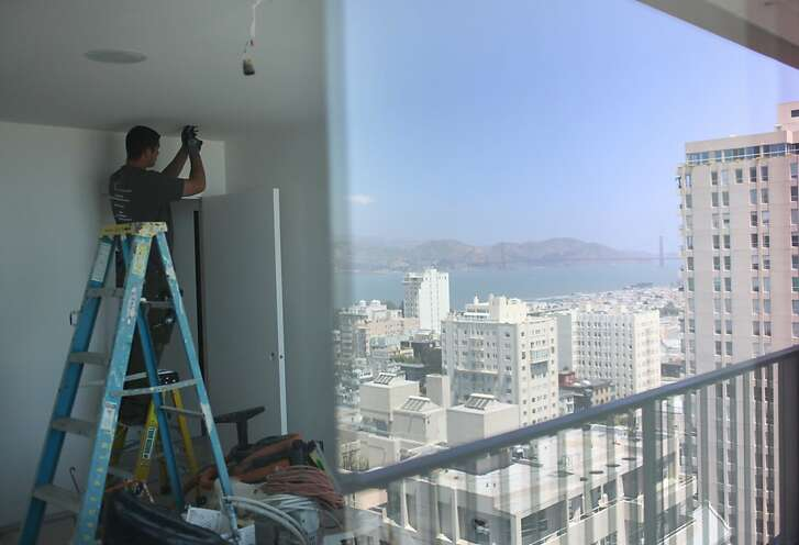 Cody Manning installs a smoke alarm in an apartment in The Summit building on May 23, 2013 in San Francisco, Calif. The apartment was undergoing a full remodel, which was a 5-6 month project.