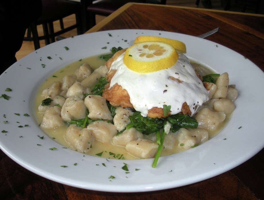 Lemon chicken with gnocchi at the Fire Engine Pizza Ca. in the Black Rock section of Bridgeport. Photo: Eileen Fischer / Connecticut Post