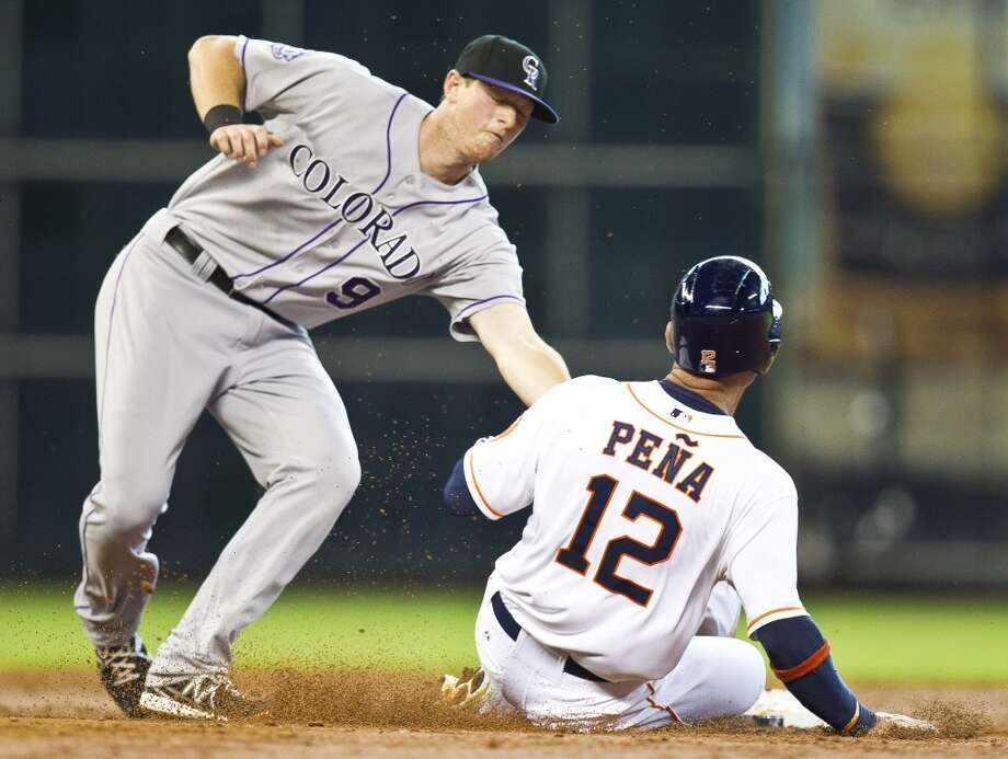 May 28: Rockies 2, Astros 1Rockies second baseman DJ LeMahieu tags out Astros first baseman Carlos Pena (12) as Pena tries to steal second during the third inning at Minute Maid Park.