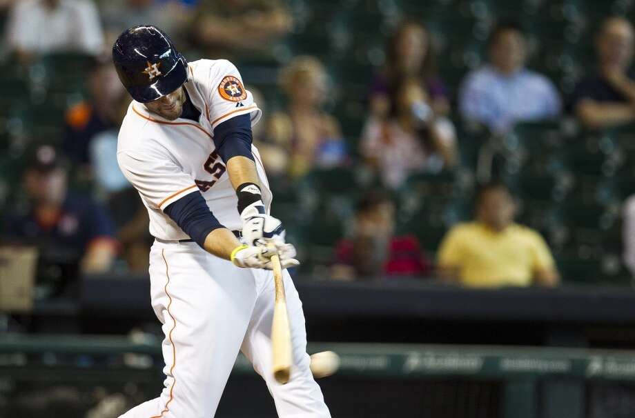 Astros left fielder J.D. Martinez hits a single during the second inning.