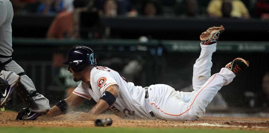 Astros catcher Carlos Corporan scores the team's lone run during the fourth inning.