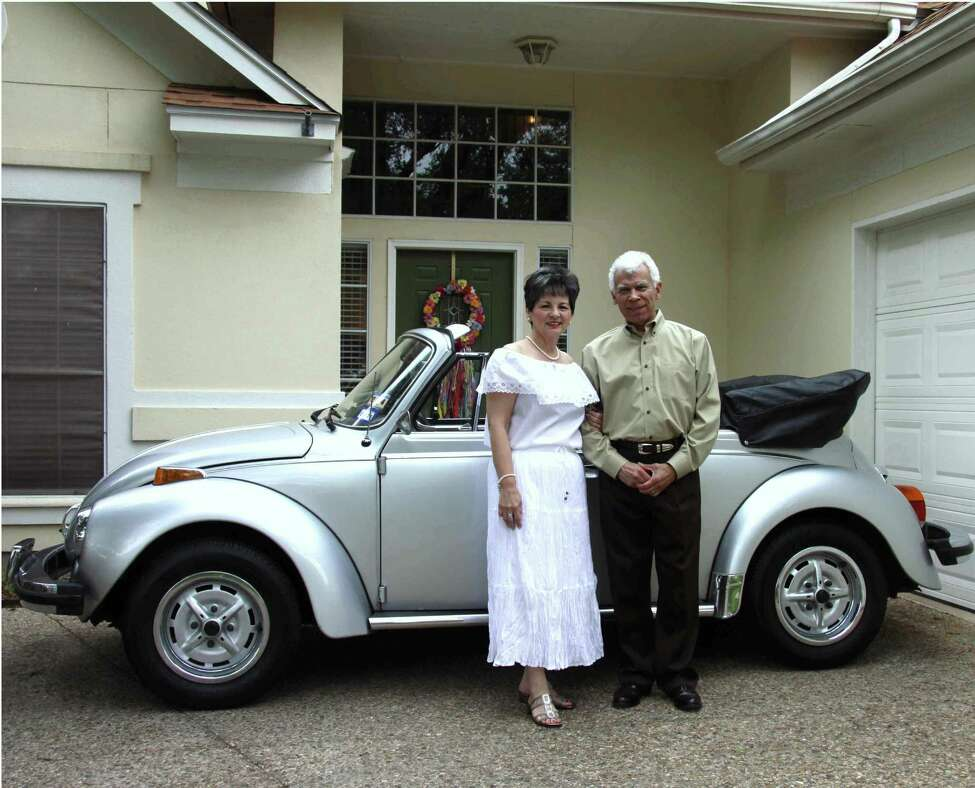 Taken on April 24, 2013 - the 35th wedding anniversary of David and Estella Cuevas posing in front of their North Central San Antonio home with their vintage 1979 VW convertible, purchased brand new in St. Louis of that year. They both retired from AT&T in San Antonio in 2002 with more than 30 years of dedicated service each.