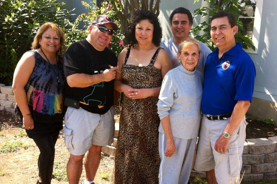 2013: Taken in the front yard of Mom's home in San Antonio (near St. Mary's University). From left to right: Yvette Hester, Paul Chapa, Annette Macias, Fred Chapa (back row), MOM - Beatrice Chapa and Anthony Chapa. Photo: Courtesy