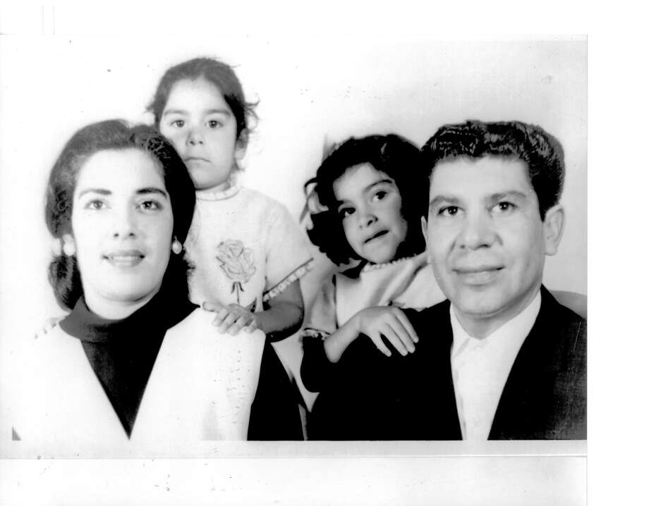Then:A family photo was taken of the Tapia family in 1962 (Sandra at age 3 behind mother; Cinda at age 4 behind father) in San Antonio Texas. Photo: Courtesy