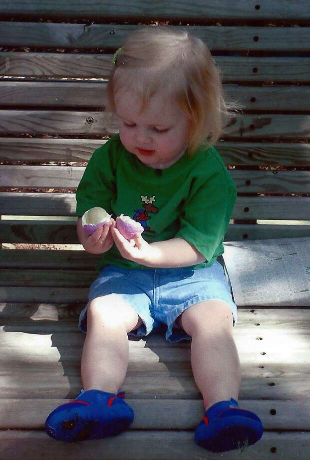 Phil's daughter, Rebecca, at age 2 in April 2006 in our back yard in Seguin, Texas. They are both trying to discover what happens when you squeeze a hard boiled Easter egg. Photo: Courtesy