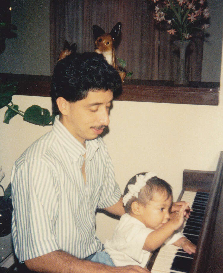 I come from a family that loves music, often breaking out into singing and playing the piano at family gatherings.  When my niece, Adriana Campa, celebrated her 1st birthday, September 1982, I gave her a first piano lesson, which she took with delight. Photo: Courtesy