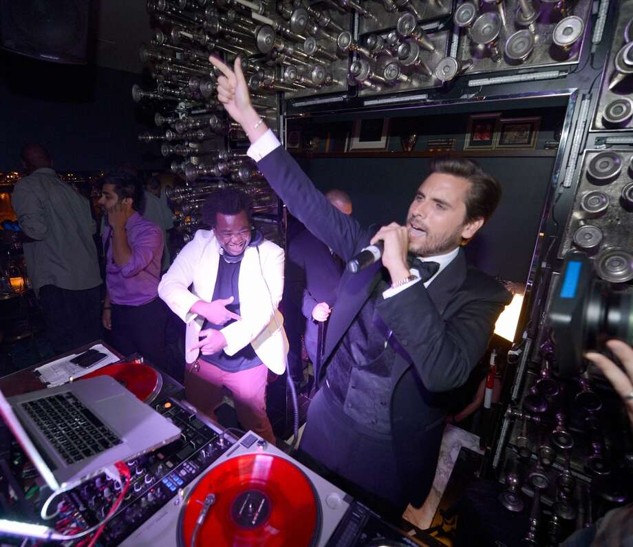 LAS VEGAS, NV - MAY 26:  Television personality Scott Disick (R) performs with DJ Reach as he celebrates his 30th birthday at Hyde Bellagio at the Bellagio over Memorial Day weekend on May 26, 2013 in Las Vegas, Nevada.  (Photo by Jeff Bottari/WireImage)