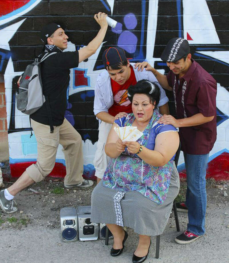 "The cast of the Woodlawn Theatre's staging of ""In the Heights"" includes (clockwise, from left) Luis Garcia Jr., Tony Pena, Miguel Ochoa and Ana Hernandez. Photo: Courtesy Woodlawn Theatre"